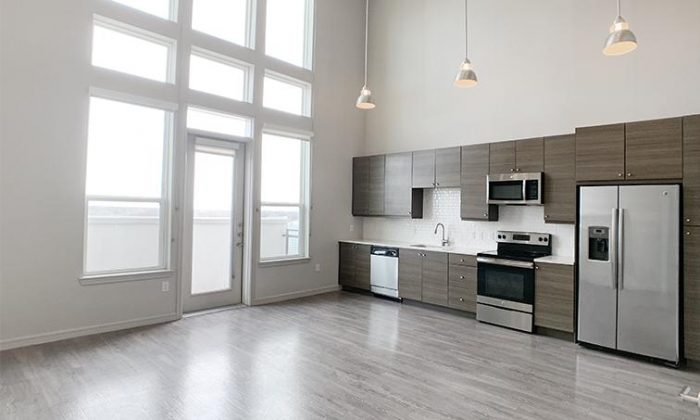 Dallas Uptown luxury apartment living room and kitchen
