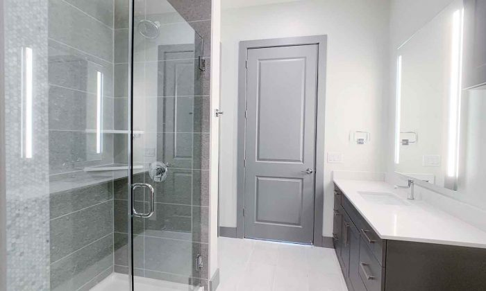 Luxury apartment bathroom with glass standing shower